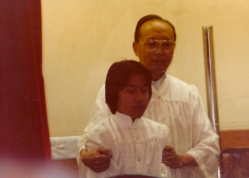 Pastor Wing baptizing Carey