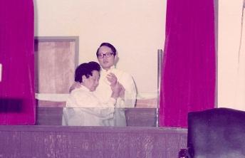 Pastor Wong baptising Mrs. Yee